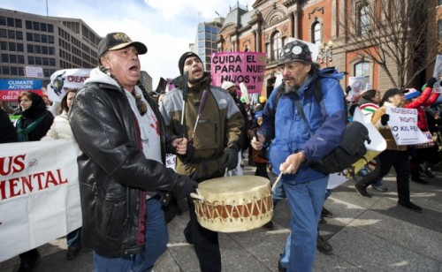 Chief Tayac of the Piscataway tribe, from left, Naiche Tayac, and William of the Lakota Nation march near the White House in Washington during a rally calling on President Barack Obama to reject Keystone XL Sunday, Feb. 17, 2013.CREDIT: AP Photo/Manuel Balce Ceneta