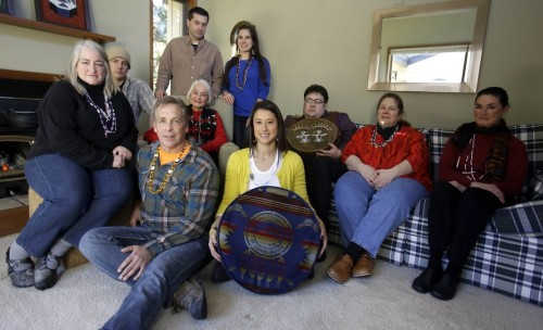 Some of the 79 people told by the Confederated Tribes of Grande Ronde they were enrolled in error. Seated on floor are Russell Wilkinson and Mia Prickett (holding the drum). Seated second row from left are Nina Portwood-Shields, Jade Unger, Marilyn Portwood, Eric Bernando, Debi Anderson, Val Alexander. Standing are Antoine Auger, left, and Erin Bernando. Photo: Don Ryan/AP