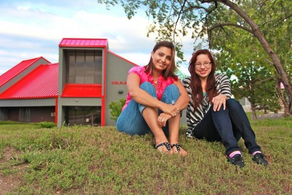 Christina RoseJazmine Good Iron (Standing Rock), left, and Adonica Little (Ogalala), right, sit in front of Oglala Lakota College in Rapid City, South Dakota.