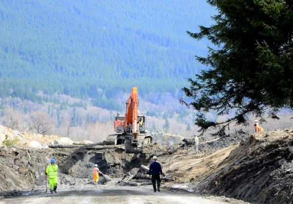 File photo of cleanup at the site of the Oso landslide site on April 3, 2014.Washington National Guard