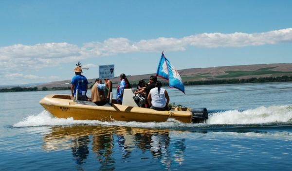 Yakama Nation fishers and tribal leaders hopped on boats to the fishing site. As a protest, they dropped a net right next to the proposed Morrow Pacific coal export facility. | credit: Courtney Flatt