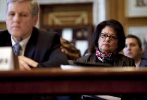 Elouise Cobell, right, looks on as Deputy Secretary of the Interior David Hayes testifies in December 2009 during a Senate Indian Affairs Committee hearing in Washington, D.C. EVAN VUCCI/Associated Press