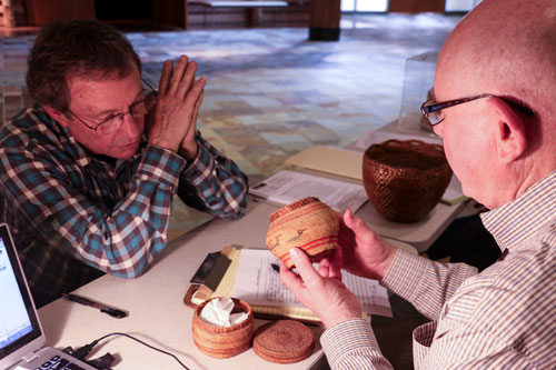Jim Freese learns how his parents' basket collection demonstrates a wealth of weaving skill and tribal history from tribes located in Washington. One of the baskets was appraised at $1,000 for its rarity.Photo/ Brandi N. Montreuil, Tulalip News