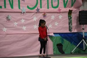 Rhianna, singing a song by pop star, Rhianna