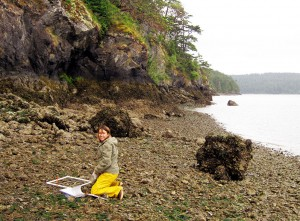 Tiffany Hoyopatubbi, water resources specialist, uses a quadrat to sample shellfish species on the beach on Kukutali Preserve