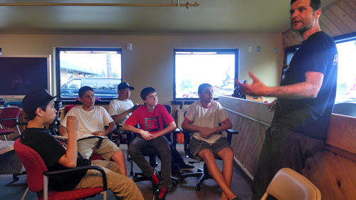 Seattle's Grindline lead designer Micah Shapiro talks with Tulalip skateboarders on May 15 about conceptual design ideas for new Tulalip Skatepark. Photo/ Brandi N. Montreuil, Tulalip News