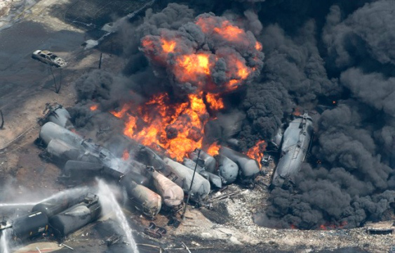 Train cars carrying crude oil burn after derailing in Lac Megantic, Quebec, July 2013.