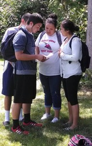 Heritage High School students, Aryik Miranda, Shawn Sanchey, Jaylin Rivera and Desirea Williams rehearse their lines before filming their next scene for 'Lady of the Woods.'Photo/ Brandi N. Montreuil, Tulalip News
