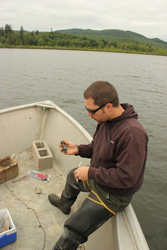 Joe Puhn, Squaxin natural resources technician, prepares temperature gauges.