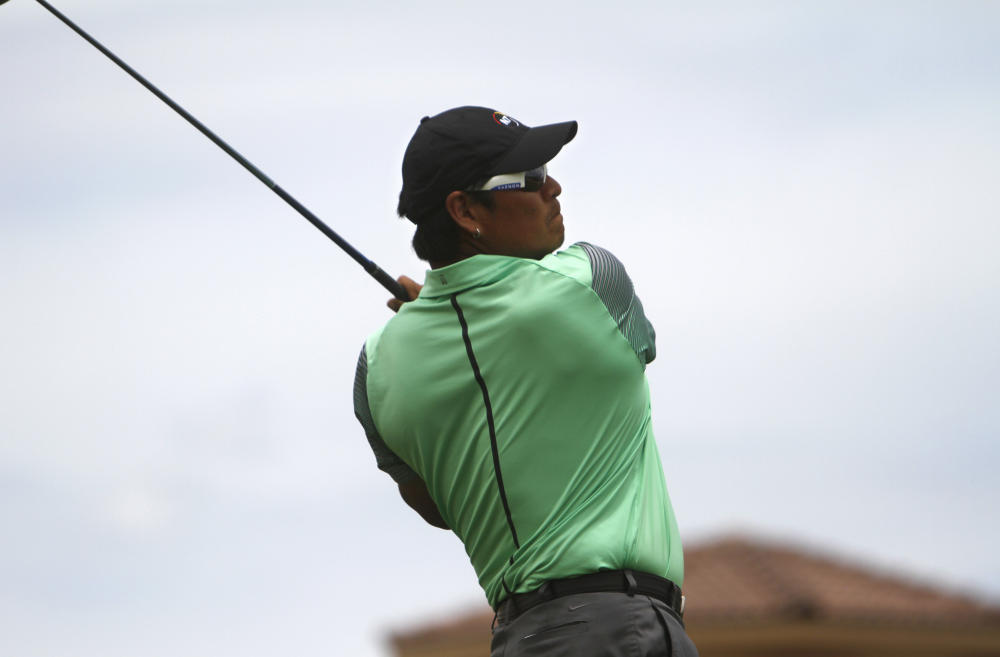 Notah Begay III tees off, Saturday, on the 15th hole during the San Juan Open golf tournament at San Juan Country Club (AP Photo/The Daily Times, Jon Austria)