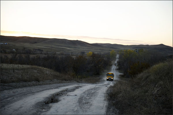 In this Oct. 24, 2013, photo a school bus heads up Tobacco Road on the Pine Ridge Indian Reservation in South Dakota.—Swikar Patel/Education Week