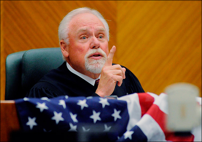 In this June 23, 2011, file photo, Chief Judge Richard F. Cebull makes a speech during a naturalization ceremony at the federal courthouse in Billings, Mont. (AP Photo/Billings Gazette, James Woodcock, File)
