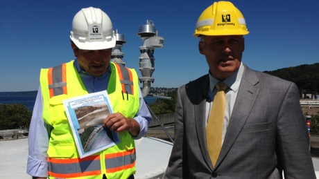 Dan Grenet (left), the manager of Seattle's West Point Wastewater Treatment Plant, leads Wash. Gov. Jay Inslee of a tour. The visit was intended to highlight the costs of climate change; in this case, as a result of seawater incursion at the facility. | credit: Ashley Ahear