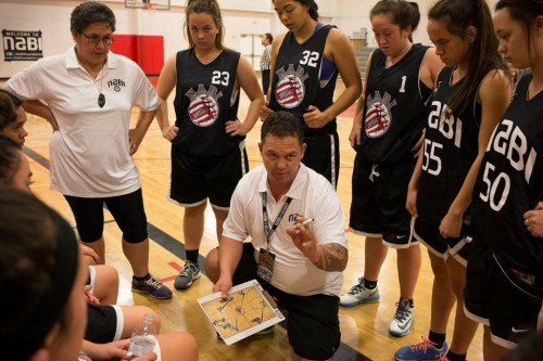 Hori Poto, center, girls' coach for New Zealand's Nga Hau E Wha, with his team during pool play against Fort Yuma, an intertribal squad.Mark Henle for Al Jazeera America