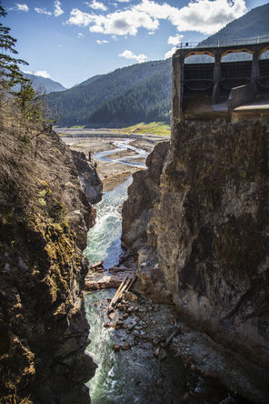 Steve Ringman / The Seattle TimesWhat's left of the 210-foot-high Glines Canyon Dam, a section of about 30 feet, is awaiting a final blast in September. In the distance, the bottom of former Lake Mills today forms part of the new Elwha Valley.