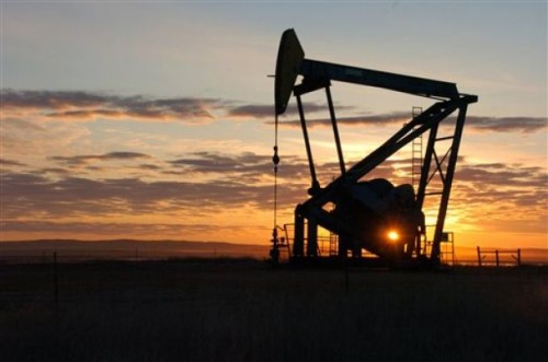 A Whiting Petroleum Co. pump jack pulls crude oil from the Bakken region of the Northern Plains near Bainville, Mont., on Nov. 6, 2013. (AP Photo/Matthew Brown)