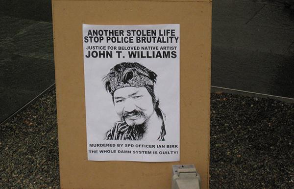 A poster demanding justice for the August 2010 shooting of John T. Williams in Seattle.