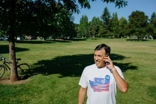 Taking a phone call after the Parade in Spokane. Ian C. Bates for Al Jazeera America