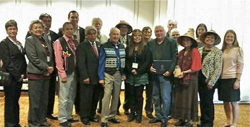 Swinomish stands with Harvard representatives for a group photo after being awarded at the 2014 NCAI Conference in Atlanta, GA. Photo courtesy Brian Cladoosby. #SalishSeaOilFree