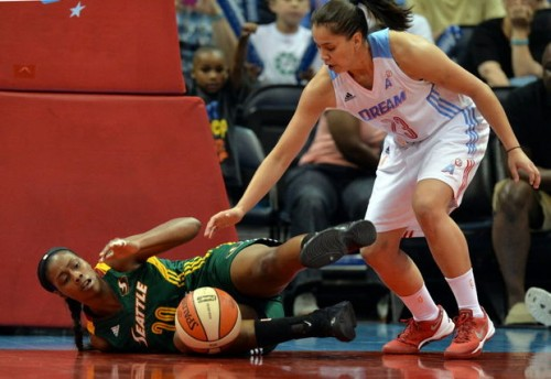 Atlanta Dream's Shoni Schimmel, right, and Seattle Storm's Camille Little reach for a loose ball during the first half of a WNBA basketball game Friday, May 30, 2014, in Atlanta. (AP Photo/Atlanta Journal Constitution, Brant Sanderlin) GWINNETT OUT MARIETTA OUT LOCAL TV OUT (WXIA, WGCL, FOX 5)