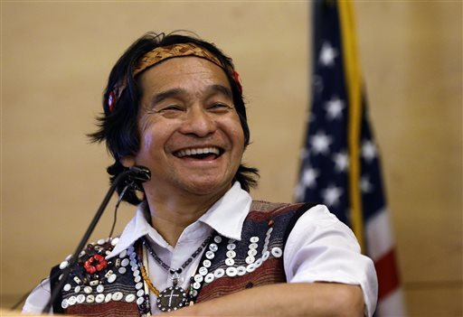 Johnny Moses, a member of the Tulalip Tribe, smiles as he speaks before a signing ceremony by Seattle Mayor Ed Murray for a resolution designating the second Monday in October as Indigenous People's Day, Monday, Oct. 13, 2014, in Seattle. Murray invited city council members and tribal leaders to the Monday afternoon signing ceremony for resolution, which the council approved a week earlier, designating it as a day to celebrate the culture and contributions of Native Americans. The second Monday in October is celebrated nationally as Columbus Day, which also has been a day to celebrate people of Italian heritage. ELAINE THOMPSON — AP Photo