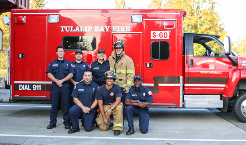 Tulalip Bay Fire Chief Teri Dodge, pictured third to last in back row, with a handful of the volunteer firefighters that serves the northern half of Tulalip from Priest Point area to Fire Trail Road. Photo/ Brandi N. Montreuil, Tulalip News