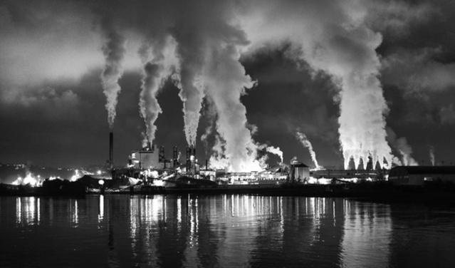 Smoke stacks during a night scene in Tacoma, Wash. Election-night shifts in the Oregon state Senate moved it closer to a carbon tax. Washington might have distanced itself further. | credit: Flickr/Tom Collins