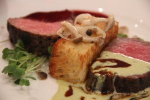 "Entree by Chef Perry Mascitti was a New York Duet: New York strip dry aged 46 days, tarragon beurre blanc and New York strip aged 28 days with wild cranberry demi and a cambazola mascarpoe ""twinkie"" with buna shimeji micro green sauté . It was paired with a Leonetti Cellar Reserve Blend, Walla Walla, Washington 2011."