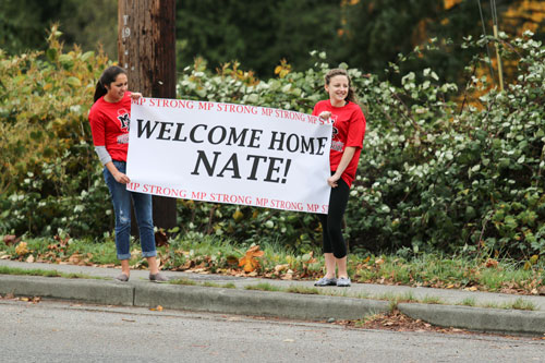 Tulalip Tribal members and Tulalip community members line the street waiting to welcome Nate Hatch home, Thursday, Nov. 6, 2014, on the Tulalip Indian Reservation. Hatch was shot in the jaw during the Oct. 24, 2014 Marysville-Pilchuck High school shooting by fellow classmate and friend Jaylen Fryberg.  (Tulalip News Photo/ Brandi N. Montreuil)