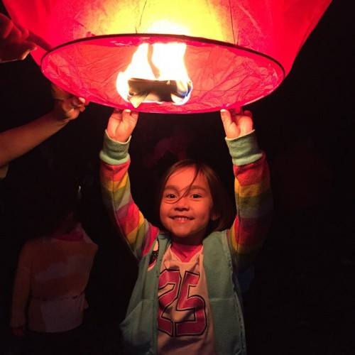 Tulalip tribal member Katie Hotts releases a lantern for the victims of the Oct. 24 Marysville Pilchuck High School shooting, Friday, Nov. 7, 2014, on the Tulalip Indian Reservation. Hotts was among 100 other community members who released 400 lanterns during the vigil. (Photo/ Natosha Gobin)