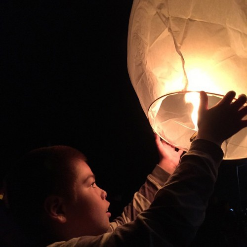 A young Tulalip tribal member releases a lantern for the victims affected by the October 24 Marysville-Pilchuck High School shooting, Friday, Nov. 7, 2014, on the Tulalip Indian Reservation.  Photo by Natosha Gobin