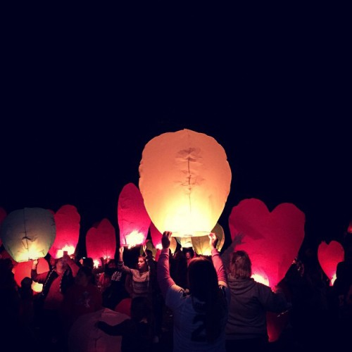 Tulalip tribal members and Marysville Pilchuck High School alumni releases lanterns for the victims of the Oct. 24 Marysville Pilchuck High School shooting, Friday, Nov. 7, 2014, on the Tulalip Indian Reservation. Nearly 100 community members  released 400 lanterns during the vigil. (Photo/ Natosha Gobin)