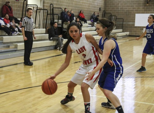 Heritage Lady Hawk #3 Myrna Redleaf makes a drive down the court in game against Grace Academy, Tuesday, Dec. 9, 2014, at Heritage High School. (Tulalip News/ Brandi N. Montreuil)