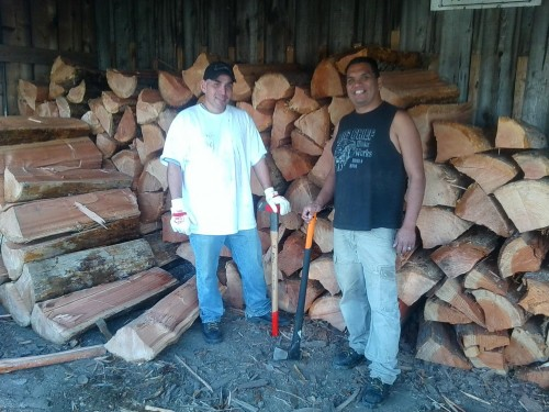 Tulalip Forestry technicians Steven Gobin and Philip Solomon deliver wood to Tulalip elders free of cost as part of a special wood program under Tulalip Forestry. (Tulalip Forestry/ Ross Fenton)