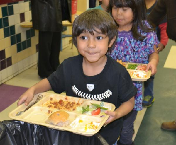 Dianne Amiotte-SeidelToas-Pueblo-InterTribal-Buffalo-Council-School-Lunches: This little guy at Taos Pueblo really enjoyed his buffalo dish and ate most of his salad, too. Taos is one of the schools included in the ANA grant awarded to the InterTribal Buffalo Council.