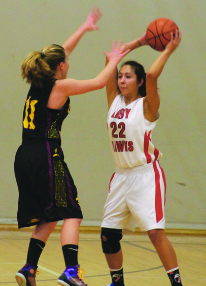 Shaelynn Sanchey looks to pass the ball in the opening possession for the Lady Hawks.Photo/Brandi N. Montreuil