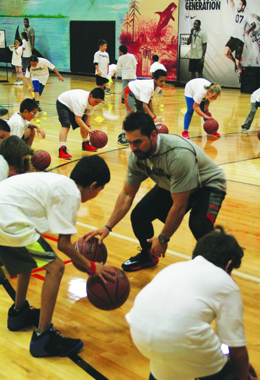 Henry Barrera, N7 trainer, practices dribbling fundamentals with the Tulalip youth. Photo/Micheal Rios