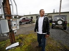 Dan Bates / The HeraldRico Jones-Fernandez waits in a gravel lot outside a vacant building on the Tulalip Reservation on Tuesday for anyone wishing to exchange needles.
