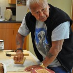 Tribal artist David Fryberg Sr. will make carve a healing message into a brass plaque that will accompany the beaded staff made by fellow artist Richard Muir. (Tulalip News/ Brandi N. Montreuil)