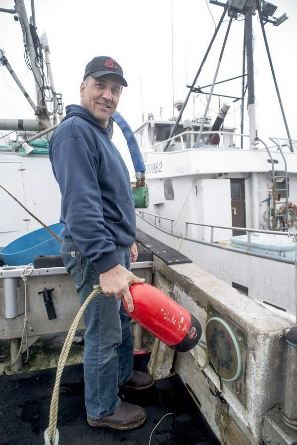 Pete Wilson, Quinault Indian Nation fisherman, demonstrates how crab pots are scanned using a sensor embedded in the pot float.DEBORAH L. PRESTON PHOTO