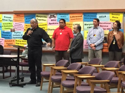 Matt Remle (blue shirt) with Denny Hurtado and Michael Vendiola from the Office of Native Education providing testimony to the Marysville School Board to adopt the STI curriculum. Photo by: Tulalip News/ Brandi N. Montreuil