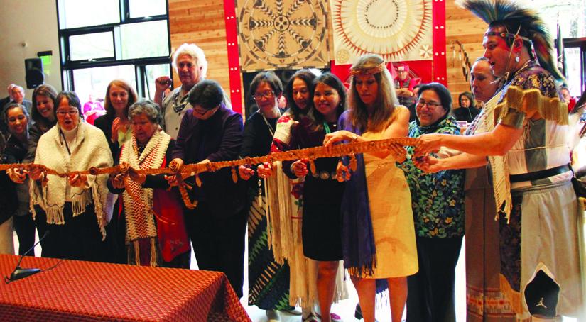 University of Washington officials and Elders Committee members cut a cedar ribbon, symbolizing the grand opening of wəɬəbʔaltxʷ.Photo/Micheal Rios
