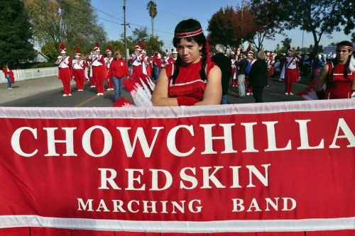 "Members of the Chowchilla High School Marching Band display their ""Redskin"" banner in 2009. Chowchilla would have to stop using Redskins if the Legislature approves a ban of the name. Lisa James Merced Sun-Star file"
