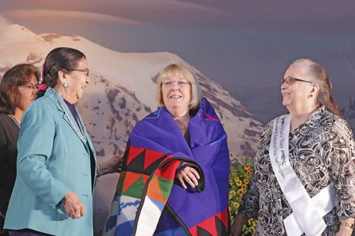 Muckleshoot Tribal Council members, from left, Charlotte Williams, Virginia Cross and Marie Starr present Sen. Patty Murray with a blanket during Tuesday's 50th anniversary celebration of the tribe's Head Start program.— image credit: Mark Klaas, Auburn Reporter