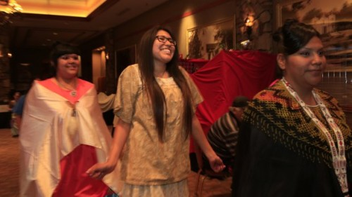 Melissa Hill, 19, from Viejas smiled as she entered the hall during a fashion show highlighting Native American clothing as part of the 13th Annual Yuman Language Family Summit. Hill made her dress to honor her Kumeyaay heritage. The event strives to maintain the language and culture of Native Americans. — David Brooks