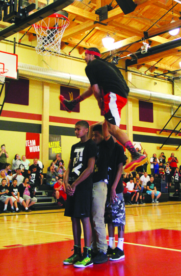"""On Thursday, May 28, the Higher Education Department held a special event for Tulalip's youth at the Greg Williams Gym. They made it possible for the youth to come together for an evening consisting of every youth's choice of dinner, pizza and Gatorade, while experiencing the unique talents of super dunker and motivational speaker, Kenny Dobbs. Every youth who attended the event also received their choice of a Kenny Dobbs 'Fly' or 'Dream Catcher' t-shirt.</p><br /><p>Dobbs is a member of the Choctaw Nation of Oklahoma, Phoenix resident and professional basketball player, but is most notably recognized as the self-proclaimed 'King of the Dunk Game'. He has toured the NBA while being sponsored by Sprite as a celebrity dunker, performing in front of sold-out stadiums during halftime shows, celebrity games and NBA All-Star Weekends. Becoming a Sprite Slam Dunk Champion and International Slam Dunk Champion means Dobbs' dunking talents have become globally recognized. As his reputation has soared sky high, like his vertical leaping ability, Dobbs never forgot where he came from and who he is representing. He now tours across the nation, going reservation to reservation as a motivational speaker for tribal youth to share his story of hope and to perform his dunking abilities while doing so.</p><br /><p>""""I'm so excited to be here and you guys are so lucky to be able to grow up in such a beautiful community,"""" Dobbs said to the estimated 150 Tulalip youth in attendance. """"Today, the main theme is for me to be able to come out and have a good time with you guys. It's going to get personal as I share who I am and what I've come from. By sharing my story I want all of you to know that I'm somebody that you relate to and can learn from. Today, I stand before you all as an International Slam Dunk Champion, but before any of that became reality there was a lot of challenges and difficulties I was facing in my life. Similar to a lot of you I'm sure.""""</p><br /><p>As an adolescent, Dob"""