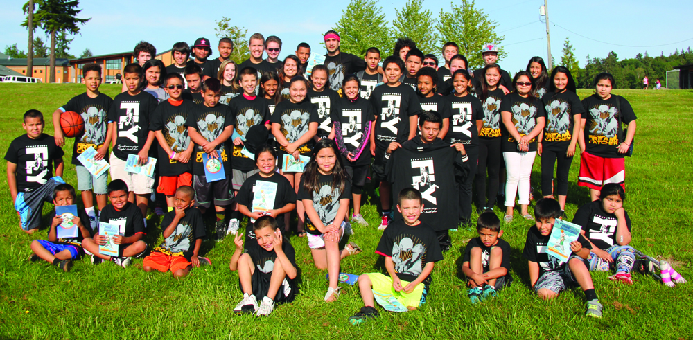Tulalip youth pose with their free t-shirts and comic books they received at the event. Photo/Micheal Rios