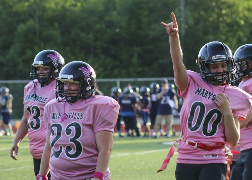 Marysville Powderpuff Football Team during a scrimmage game against the Arlington Eagle Mamas on October 13, 2015. Photo/ Tulalip News, Brandi N. Montreuil