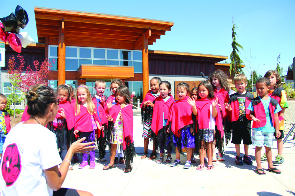 Spirited youngsters performed songs during the Early Learning Academy grand opening ceremony. Photo/Micheal Rios