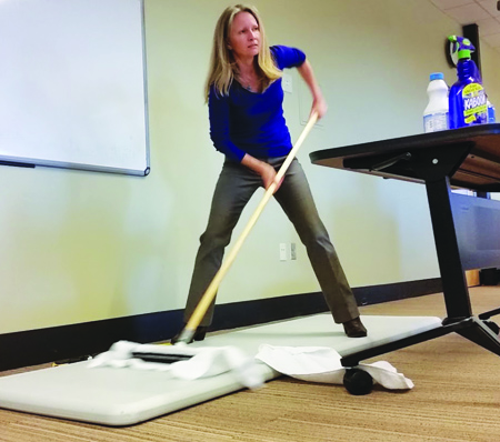 Denise Frakes of Blue Sky Services, gives tips on dumping toxic cleaners and using a little elbow grease for a safer, cleaner home. Photo/Niki Cleary, Tulalip News